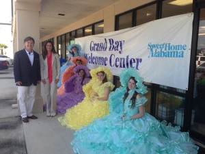 CAP President & CEO Wiley Blankenship with Lynne Brown, executive director of the South Mobile County Tourism Authority, and Azalea Trail Maids.
